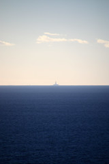 Distant rig (Paul Threlfall) Tags: ocean indianocean oilrig gasrig sky sea distant horizon