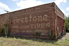 Firestone Fabric and Cord Tires Ghost Sign - Lyons,Texas (Rob Sneed) Tags: usa texas lyons burlesoncounty unincorporatedcommunity sign ghostsign firestone fabricandcordtires mostmilesperdollar advertising abandoned archiecture vintage firestonetires texana americana tx36 hwy36 smalltown roadtrip roadside brandname 20thcentury handpainted gatlinggatling drygoods groceries rural