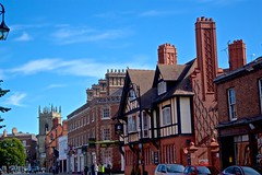 Grosvenor Street Chester (TERRY KEARNEY) Tags: buildingsarchitecture building chimney window architecture shops pubs street intersection road cars trees people chester cheshire skyline sky church steeple tower buildings canoneos1dmarkiv daylight day explore europe england kearney skies landscape cityscape city chestercitycentre oneterry outdoor streets sunshine terrykearney weather 2018