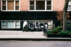 The parent is absent (NYC Macroscopist) Tags: street manhattan stollers portra400 film leica vintage vintagelens summicron 50mm 35mm colors abandoned quirky urban