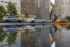 Morning Rush (Amar Raavi) Tags: morning motionblur motion vehicle car taxi cab reflection puddle water skyscrapers buildings lowangle architecture centralpark nyc newyork manhattan cityscape outdoors urban street longexposure day grandarmyplaza usa