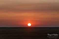 A smoky haze of a sunrise