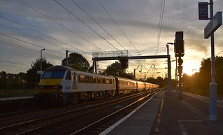 AC Electric 90002 propels the 19.00 London Liverpool Street to Norwich away from Ipswich after its booked stop and into the first August Sunset of this year. 01 08 2018