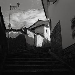 Backstreet, Cusco, Peru (austin granger) Tags: cusco peru backstreet steps shadows geometry lamp square film gf670