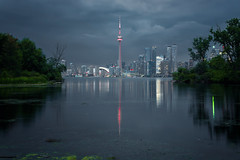 A Time To Reflect (Paul Flynn (Toronto)) Tags: toronto reflection cn tower city downtown water harbour lake cityscape skyline island calm clouds night lights moody waterfront harbourfront