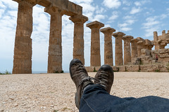 The Greek Ruins of Selinunte - Traveling Boots (virtualwayfarer) Tags: marinella sicilia italy it selinunte greek greekruin ruin city greekcity roman romancity ruins ancientworld selinous sicily italian sicilian temple templeofhera greekcolony hellenistic architecture spring roadtrip seaside archaeologicalruin archaeologicalsite acropolis necropoleis boots bootshot travellingboots spiritoftravel signaturephoto travelsignature crossedfeet crossedlegs exploring relaxing pillars columns greekcollumns history alexberger europe european travelphotography travelblogger explore visitsicily visittosicily westernsicily sonyalpha a7rii blue sky