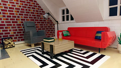 Night in the Attic Apartment (Heksu) Tags: lego moc atticapartment couch carpet fireplace armchair coffeetable floorlamp whiskey brickwall plant heikkim