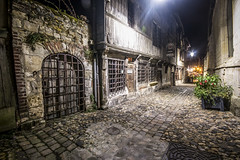 """looking down night-time rue de la Prison towards the Vieux Bassin, Musée de la Marine occupying the ancient Église Saint Etienne on the right, Musée d'Ethnographie on the left. Honfleur, Calvados, Normandy, France (grumpybaldprof) Tags: canon 70d """"canon70d"""" sigma 1020 1020mm f456 """"sigma1020mmf456dchsm"""" """"wideangle"""" ultrawide """"fineart"""" ethereal striking artistic interpretation impressionist stylistic style contrast shadow bright dark black white illuminated colour """"longexposure"""" """"dark night nocturne nighttime """"lowlight"""" honfleur normandy normandie france calvados """"ruedelaprison"""" """"muséedelamarine"""" """"muséed'ethnographie"""" """"églisesaintetienne"""" nuit nocturnal vieuxbassin noir detail mood atmosphere halftimbered buildings church museums"""