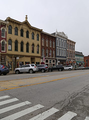 Buildings — Georgetown, Kentucky (Pythaglio) Tags: georgetown kentucky scottcounty building structure historic ornate italianate brick threestory cornice brackets 22windows hoodmolds painted storefronts street cars automobiles