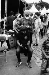20180817 kulturkalaset Göteborg 2018, bältesspännarparken, gustaf adolfs torg - canon f1n, 35mm 2.8 - polypan f 50 at 100 - d76 stock 10 min (Sina Farhat - Webcoast) Tags: light ljus gothenborg göteborg sweden sverige 031 people folk kulturkalasetgöteborg2018 bältesspännarparken gustavadolfstorg analog film negativ 35mm blackandwhite svartvit monochrome polypanf50 pushedto100 1 d76stock10min dslrscanned canonf1n canon35mm28fd raw lightroomclassiccc photoshopcc