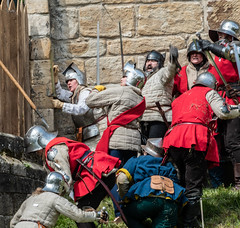 The siege of Prudhoe Castle - DSC_9569-2 (Kevan Brassington) Tags: prudhoe england unitedkingdom gb leadhistoricalreenactmentsociety prudhoecastle medieval knight montagu battle armour chainmail attack castle sword yorkist yorkists lancastrians waroftheroses roses