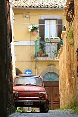 what else...? (daniel.virella) Tags: orvieto umbria italia fiat cincoecento 500 red alley door window balcony town city picmonkey