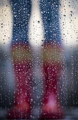 Rainy Days And... (CoolMcFlash) Tags: dof depthoffield person boots rubber red jeans focus raindrops wet water window legs fujifilm xt2 flickrfriday rainydaysand rot tiefenschärfe fokus gummistiefel regentropfen regen nas wasser fenster beine female fotografie photography woman frau xf35mmf14 r