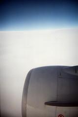 7F (.grux.) Tags: holgak280 film plasticfantastic agfavista400 expiredfilm windowseat 7f engine cloud sky flying plane airplane saskatchewan