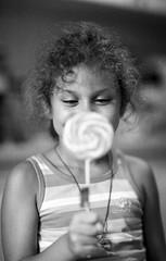 Sweet Joy (Vlad Bobe) Tags: child daughter lollypop joy hapiness happiness girl fomapan fomapan200 monochrome blackwhite canon canoneos1v
