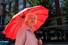 Parasol (johnjackson808) Tags: sun vancouver parasol woman fujifilmxt1 umbrella streetphotography red people yaletown daviest downtown