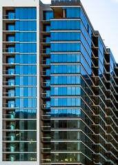 Atlanta Architecture (swampzoid) Tags: perspective correction flute glass tower new modern construction atlanta balconies windows condominium building edifice blue facade