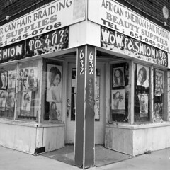 wow-fashion (kaumpphoto) Tags: rolleiflex tlr 120 bw black white street urban city saintpaul store retail fashion wow braids suppy supplies door front corner women african poster posters hair lock handle brick cement sidewalk hairstyle lifestyle window beauty shop business