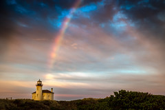 Coquille River Lighthouse (Manuela Durson) Tags: coquille river bandon lighthouse sunrise sky clouds cloudscape beautiful early morning colorful colors landscape oregon oregoncoast southernoregon pacificnorthwest dunes nature rainbow