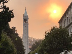 Fiery Dawn on Campus (Melinda Stuart) Tags: campanile uc tower sather sun dawn morning cloud fiery red yellow strange wonder east fire smoke air quality