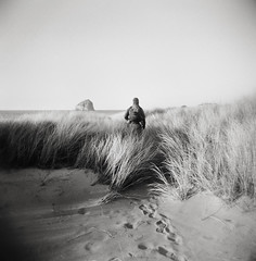 henryscapes, part one (manyfires) Tags: henry boy child baby son family love childhood portrait bw blackandwhite film analog peoplescape people holga plastic toycamera michael dad father hiking hike pnw pacificnorthwest pacificocean ocean beach beachgrass haystackrock capekiwanda pacificcity sand footprints shore shoreline coast coastline