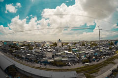 Blue Afternoon (AllanAnovaPhotos) Tags: muntinlupa alabang starmall clouds bus buses houses perspective fisheye fisheyelens samyang rokinon 8mm philippines