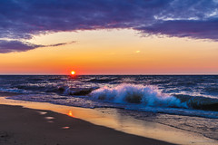 the huron beach (john dusseault) Tags: beach lakehuron wave splash sunset clouds greatlakes ig facebook flickr