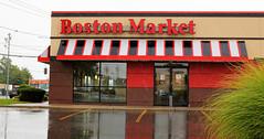 Boston Market on a rainy day. (henulyphoto) Tags: food rain architecture restaurant eat street badweather plant car sky graysky wires