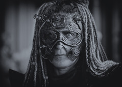 Portrait from the Whitby Steampunk Weekend IV - Days Like These (Gordon.A) Tags: yorkshire whitby steampunk whitbysteampunkweekend iv dayslikethese wsw july 2018 convivial creative costume mask masque maschere culture lifestyle style fashion lady woman people street festival event eventphotography amateur streetphotography pose posed portrait mono monotone naturallight naturallightportrait digital canon eos 750d sigma sigma50100mmf18dc