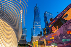 Hello World! (Amar Raavi) Tags: wtc worldtradecenter freedomtower nyc colorful streetart art mural graffiti newyorkcity skyscraper cityscape skyline architecture oculus transportation hub path station train manhattan lowermanhattan downtown financialdistrict usa buildings outdoors