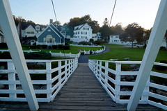 Bridge Walk (Heather's Reflections Photography) Tags: bridge walk walking wooden white planks maine twilight light lighthouse newengland sunset ogunquit water ocean sea seaside atlantic houses colonial capecod house building fall autumn summer nature spring green grass porch fence picket