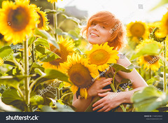 young redheaded woman in the field of sunflowers holding a huge bunch of flowers in a sunny summer evening (ig_royal6969) Tags: backlight beauty yellow beautiful girl nature summer sunflower young field flower portrait pretty woman happiness outdoor sunny caucasian cheerful fresh happy joyful countryside season sky dress enjoy hair landscape smile fashion blooming green natural one person cute agriculture country sun sunlight face freedom human health floral hand tenderness redhead embrace hug sale shutterstock