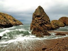 Fara's beach (Jenne Barneveld) Tags: portknockie sea scotland scenery water waves rocks coast moraycoast morayshire moray northsea faras bay rock sky pebb coastline moraycoastline longexposure olympusem10 landscape ocean
