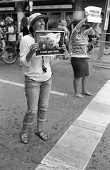 Protesters (dennisfromthere) Tags: analog street photography bw ontario canada ilford monochrome blackandwhite bandw 2017 noiretblanc 400 urban toronto people nikon bloor protest city intersection yonge august classicblackwhite