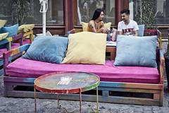 Aug 18, 2018 (pavelkhurlapov) Tags: street cafe couple talking sofa table cobblestone parasol colors streetphotography drinks