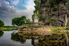 Buddhist Shrine (Rod Waddington) Tags: vietnam vietnamese building buddhist temple shrine river reflection water kast mountain trees stone religion religious landscape outdoor classic