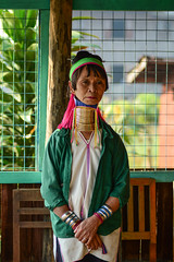 Kayan woman (Long Neck People) in Myanmar (phuong.sg@gmail.com) Tags: adornment armlet asia asian bangle bracelet brass burmar colorful decoration device elongating fabrics heavy inlay inle karen kayan lake long longnecked minority myanmar national neck one ornament padaung people ring scarf shan shop spin spiral state textile tourism tradition traditional travel tribe village weave white woman workshop yarn