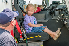 Andi made a beeline for the first fire engine she saw! (Charles G. Haacker) Tags: trucks trains planes automobiles tractors fireengines firefighters stearman airfield
