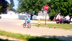 Summer cyclist! (Maenette1) Tags: summer cyclist girl neighborhood menominee uppermichigan flicker365 allthingsmichigan absolutemichigan projectmichigan
