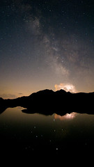 Our home galaxy fights against a thunderstorm (lucapoll) Tags: star photography milky way mountains water reflection thunderstorm flash lightning perfect timing nature samyang 12mm
