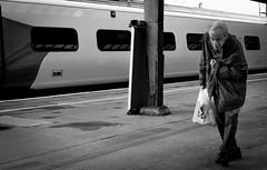 2018_248 (Chilanga Cement) Tags: fuji fujix100f fujifilm xseries x100f bw blackandwhite monochrome flickrbw people candid preston prestonstation platform virgintrains man age wisdom carrierbagman