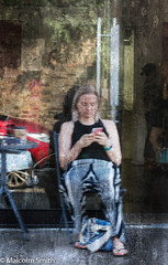 Modern Communication 30 (M C Smith) Tags: phone communication sitting woman pents k3ii white black oil painting stripes red chair standing women reflection car bag blue pink pavement