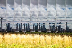 City - Reflected (Karen_Chappell) Tags: city urban travel usa chicago illinois glass building architecture reflection reflections abstract yellow blue grass sky clouds distortions navypier