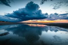 the light is on (ylemort) Tags: nature sunset landscape sky water scenics cloudsky reflection beautyinnature blue sea lake cloudscape outdoors dusk sunrisedawn summer tranquilscene sunlight beach everypixel koksijde kust canon canon5dmkiv