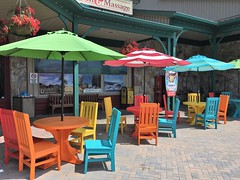 McHenry MD ~ shopping center color (karma (Karen)) Tags: mchenry maryland shoppingcenter chairs tables umbrellas signs benches hbm brightcolors iphone windows hww topf25