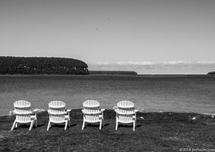 The quintessential Door County image - empty Adirondak chairs looking out over water (Jim Frazier) Tags: study q3 vacant sunny 3d3layer 201808doorcounty adirondackchairs bw bay blackandwhite bluff calm chairs cloudy desaturated door doorcounty empty ephraim furniture harbor jimfraziercom lake lawn monochrome nature resort roadtrip sea water wi wisconsin scenery scenic landscape f10 fastpictures green instagram jfpblog