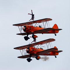 Wing Walkers (Geoff Henson) Tags: aerobatics acrobats wingwalker biplanes aeroplanes airplanes aircraft planes pilots cockpits wheels sky