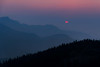 Orbiting Orange Sorbet (Carl's Captures) Tags: sunrise dawn daybreak rockymountainnationalpark rmnp manyparkscurveoverlook frontrange rockymountains colorado continentaldivide nature outdoors hazy smoke smoky forestfires summer horizon morning bluehour pink orange layers landscape atmosphere atmospheric moody mood semisphere journey memories awe inspiration exploring experiencing discovering beauty serenity trees flora silhouettes minimalism trailridgeroad route34 haze hemisphere orangesherbet orangesorbet blueberrypie halfscoop nikond7500 sigma18300 photoshopbyfehlfarben thanksbinexo