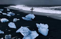 Surfing in Iceland (yan08865) Tags: sea ocean water sky iceland rock sand people surfing surfer black beach ice rocks breiðamerkursandur vik hofn iceberg glacier landscapes nature seascapes lava volcanic pavlis supershot