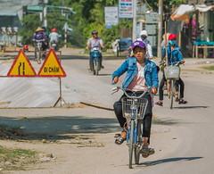 -c20180510-810_7475 (Erik Christensen242) Tags: cátminh bìnhđịnh vietnam vn students bicycle street sunshine tools pickaxes